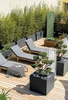 ImageIn planters on roof terrace in Annecy When design is invited on the roofs  terrace  Beautiful fitting of a rooftop of 165m  in the city center of Annecy терраса