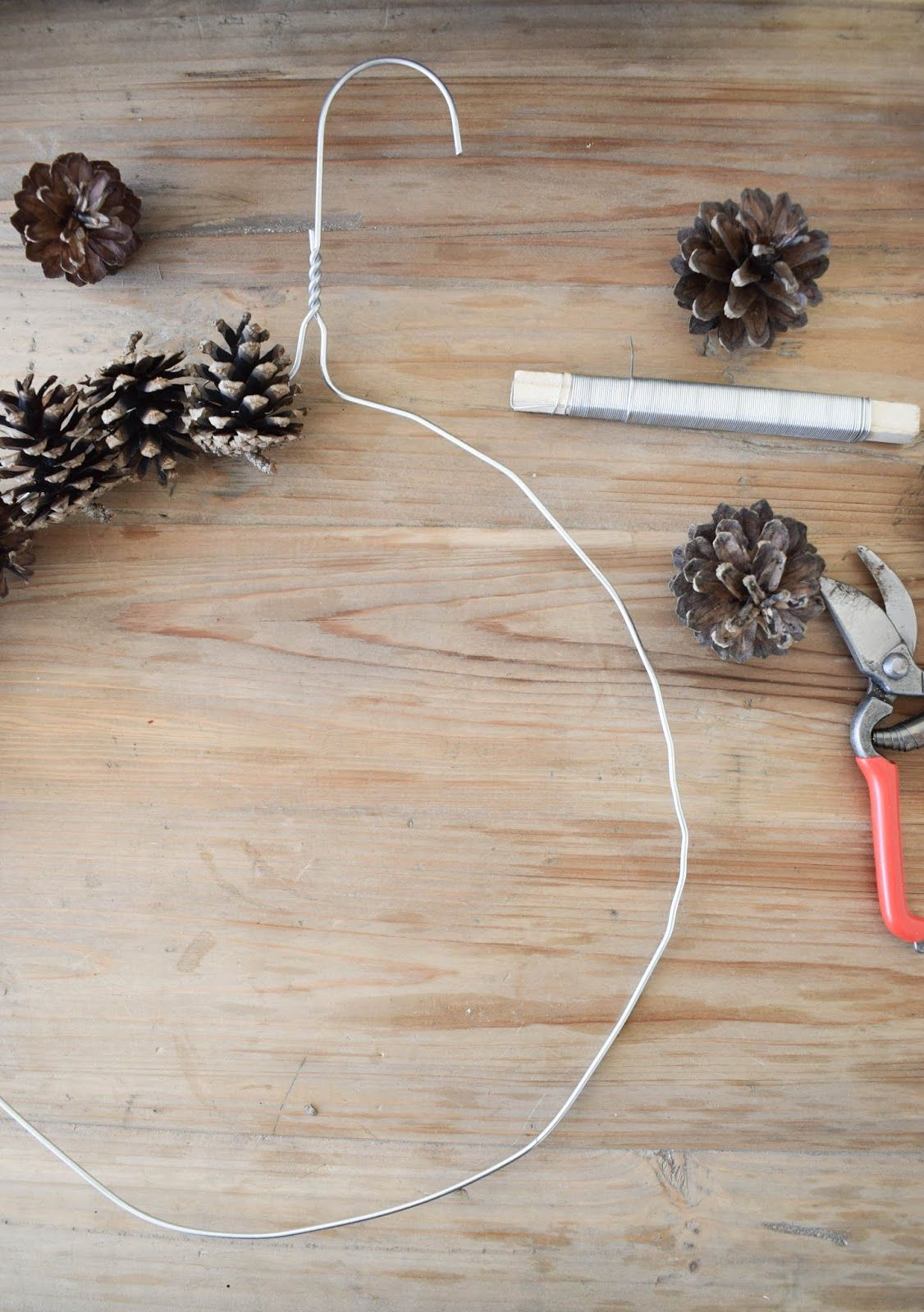 Photo of Wreath tie with cones for fall Christmas with wire and hangers. On…