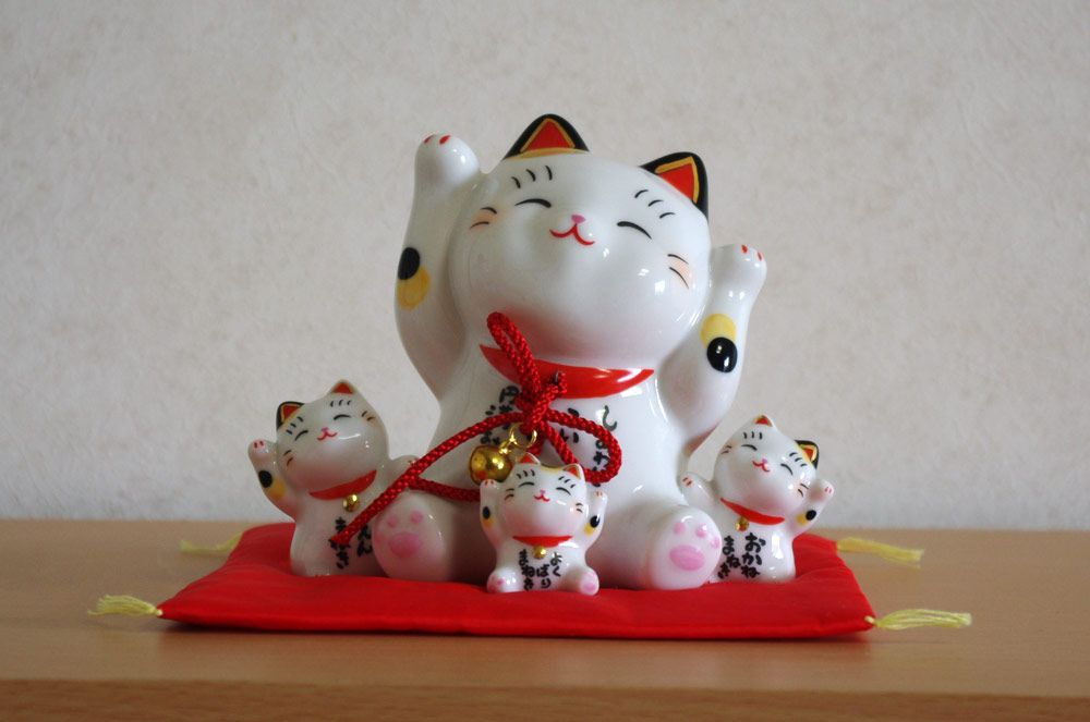 Japanese Maneki Neko figures (Lucky Cats) are very popular and believed to bring good luck to their owners. There are Maneki Neko ceramic figures, keychains, cellphone straps and many other items!