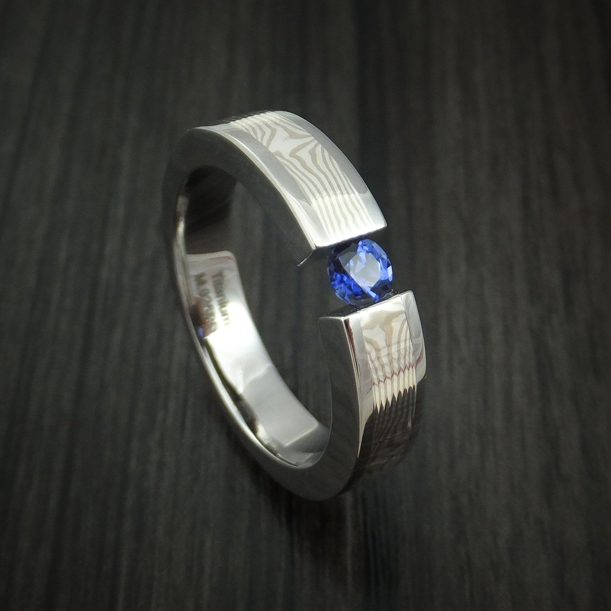 Titanium and Mokume Gane Ring with Sapphire Tension