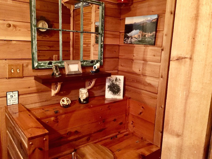 Guest bathroom in loft of Southland Log Home. Hand Hewn
