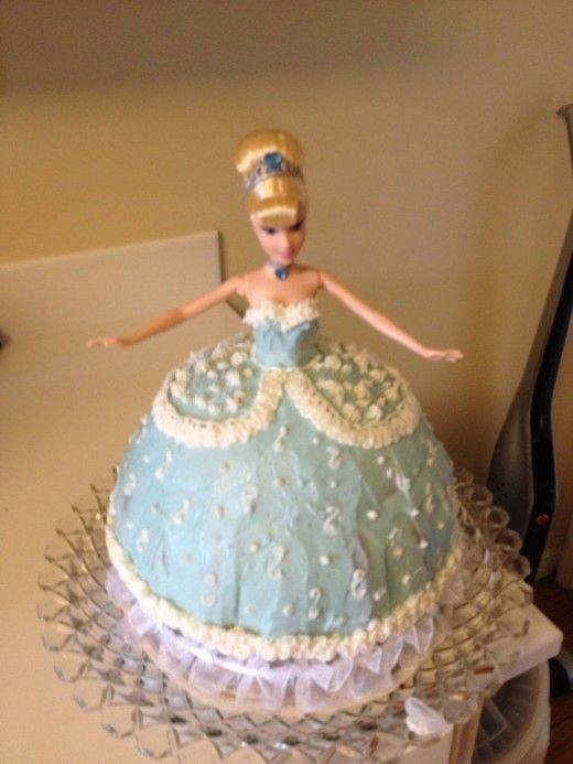 """Step by step instructions for making a """"Princess"""" cake for a little girl's birthday.  Make and decorate a skirt cake using a Barbie-type doll."""