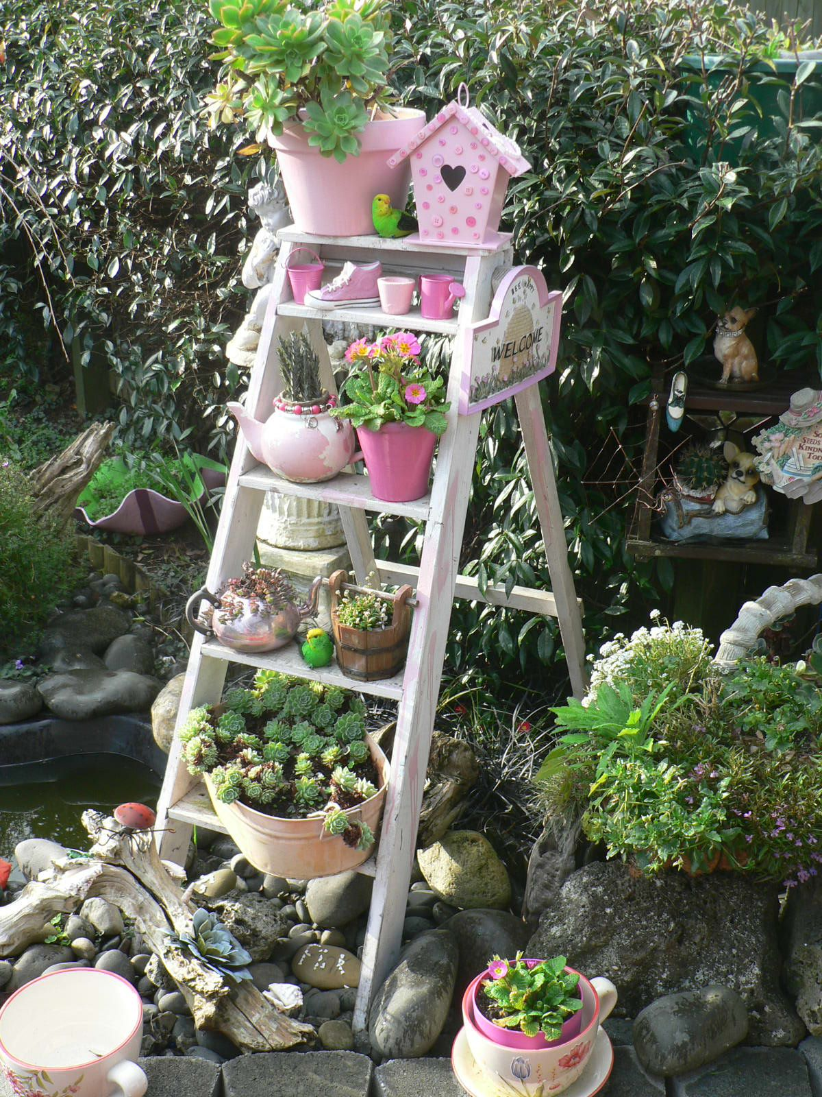 old ladder garden idea put grand kids potted plants on. Black Bedroom Furniture Sets. Home Design Ideas