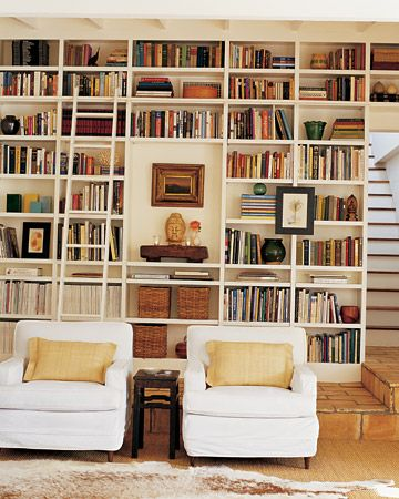 Delightful Light Library Space, With Lovely White Armchairs And Floor To Ceiling  Bookshelves, Artfully Stocked. Floor To Ceiling Bookshelves With Ladder.