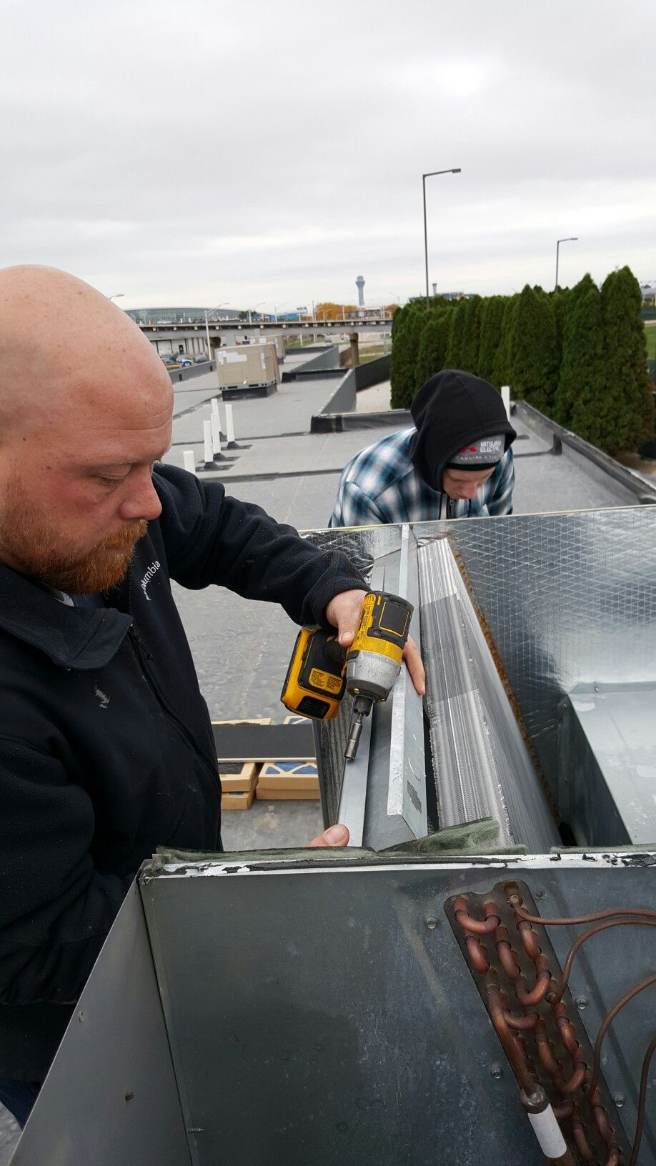 Scott and Steve replacing a roof top unit evaporator coil