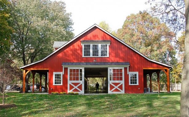 Timber frame porches and accents on a large horse barn in for Red metal barn
