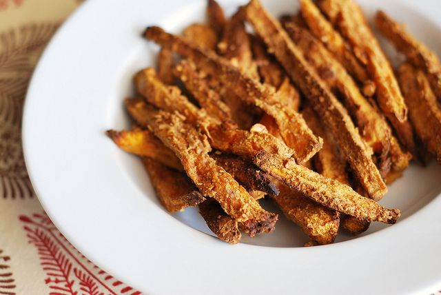 2 medium sweet potatoes, peeled and cut into thin fry-like strips 3 tablespoons chunky peanut butter 1 tablespoon extra virgin olive oil 1/2 teaspoon fine grain sea salt  Preheat oven to 400F and line a baking sheet with parchment paper.  In a medium size bowl, mix together the peanut butter, olive oil, and salt. Take sweet potatoes and toss in bowl with your hands until fully coated. Line up on baking pan and cook at 400F for 20 minutes. Flip and bake for another 10 – 20 minutes or until…