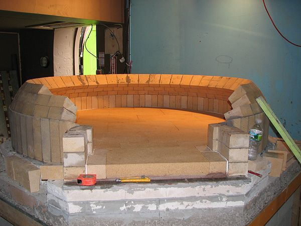 """60"""" Commercial Brick Pizza Oven – Form-Free Construction.  Dome for this 60"""" net baking space commercial pizza oven is built completely form-free. This technique is only possible keeping most joints within 1/8"""". It results in very tight, attractive, clean and extremely stable dome – ideal for commercial environment. Oven proportions and shape is classic for true Neapolitan-style pizza ovens. Dome's height at peak: 18"""", dome thickness: 4.5"""", hearth thickness: 2.75"""". Hearth mater #brickpizzaovenoutdoor"""