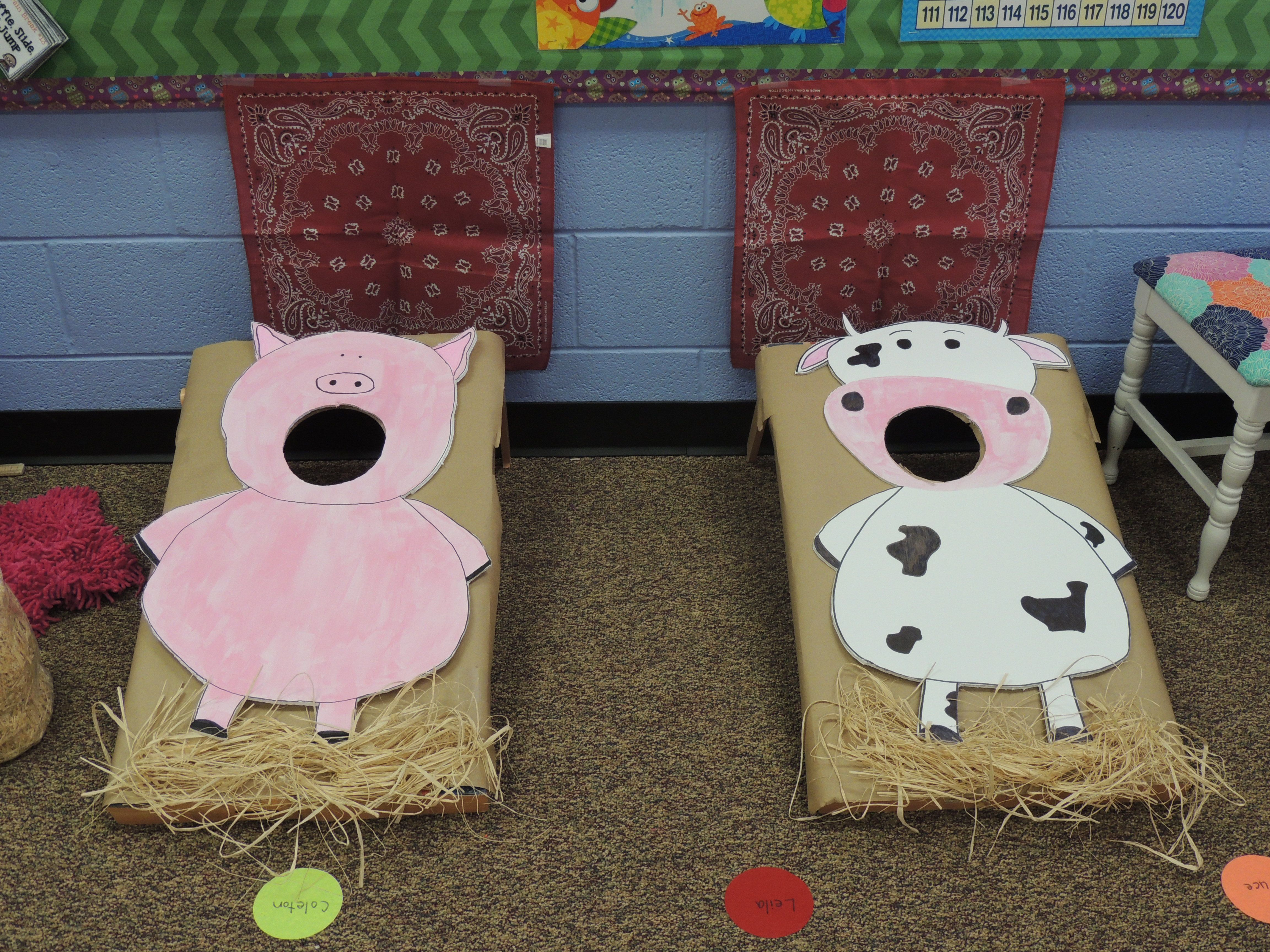 Feed the cow and pig bean bag toss game for farm theme party in the ...