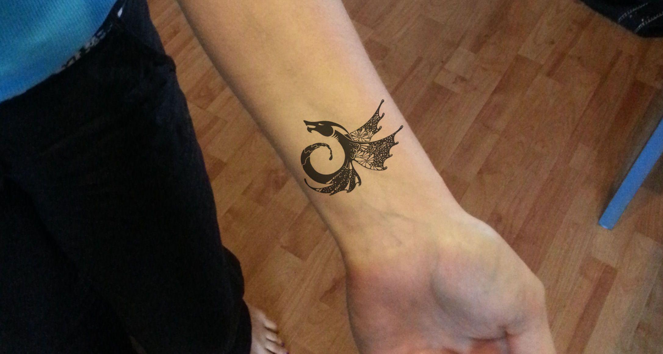 Tribal dragon wrist tattoo idea Do I have this as my