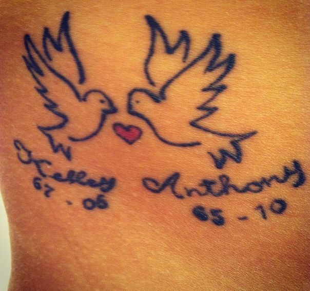 45 Sincere Rest In Peace Tattoo Ideas: Tattoo Number 1: Doves. Rest In Peace To My Godparents