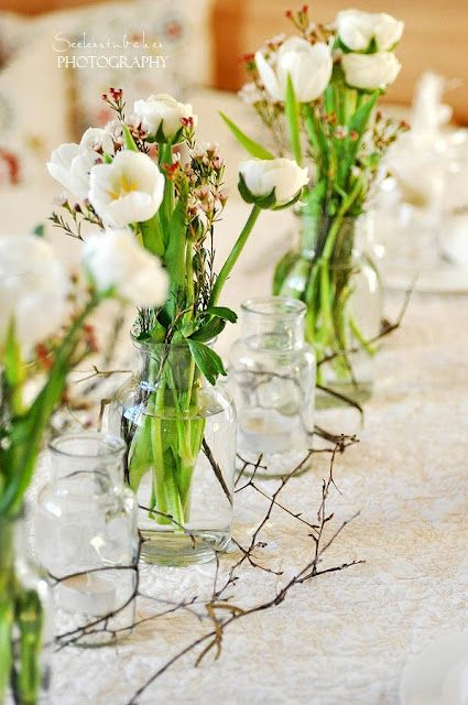 A Row Of Sweet And Simple Flower Arrangements For The Dining Table