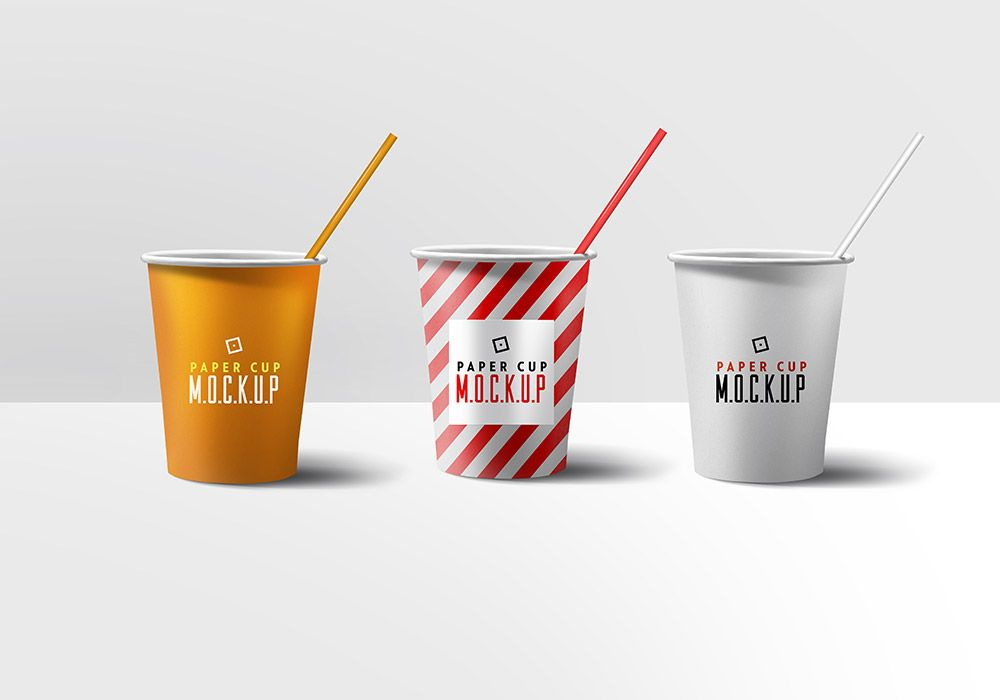 a set of 3 paper cup mockups in white orange and stripes you can
