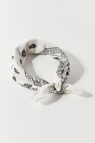 """Vintage-inspired bandana cut square with the classic western pattern that goes perfectly with everything. Perfect knotted around your neck, as a headband or strung around a bag strap for a rustic take on a trend we love.Content + Care. 100% Cotton Machine wash ImportedSize. Length: 20"""" Width: 20"""""""