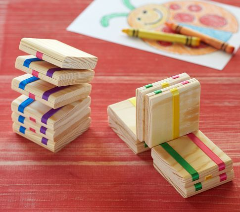 Jacob's Ladder. Watch kids become absorbed with trying to figure out how this classic optical-illusion toy works. When held at one end, the wood blocks appear to magically flip end over end down the ribbons.