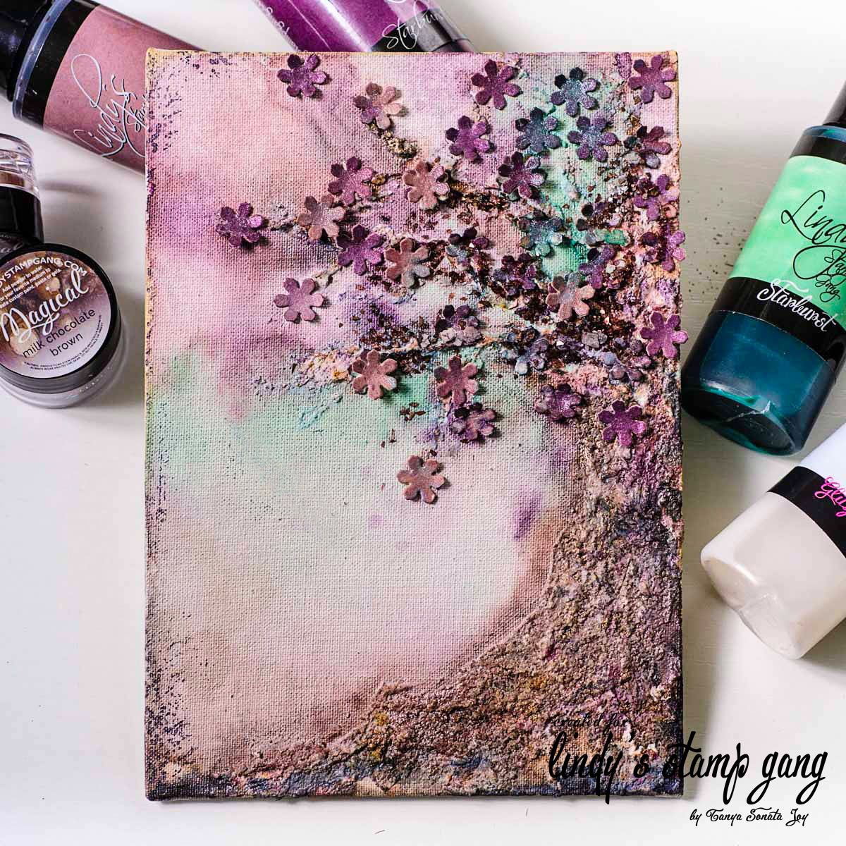 Hello everyone! It's Tanya here. Today I would like to show you my new canvas. I created it with amazing colors from Lindy's Stamp Gang January Color Challenge and same color magicals. The color pa...
