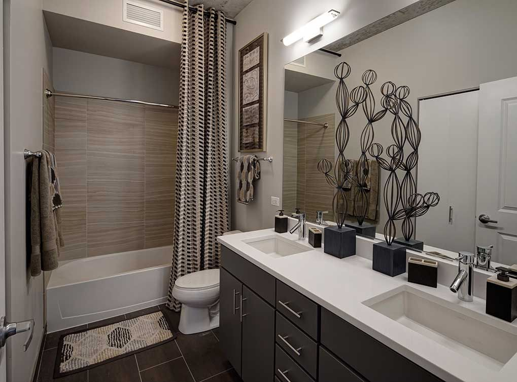 Luxury Apartments Condo Floor: Model Bathroom Featuring Porcelain Tile Bath Flooring