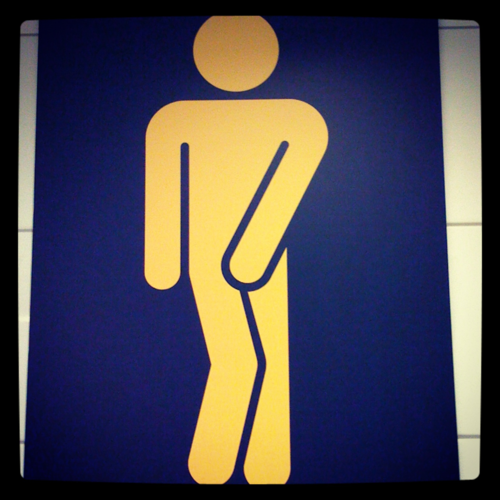 Actual bathroom sign at airport in Norway.  Is it the sign that the toilet is out of order?