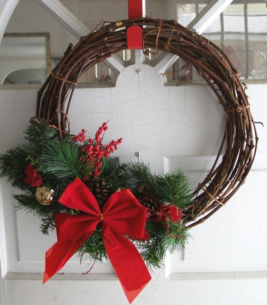 Super simple do it yourself christmas front door wreath design with super simple do it yourself christmas front door wreath design with cool branches circle pine sprays pinecones red berries and lovely christmas solutioingenieria Gallery