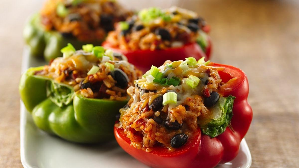 Spicy Chorizo-Stuffed Peppers recipe and reviews - Add some spice to classic stuffed peppers with this Mexican-inspired filling. You'll need only 15 minutes to get them in the oven.