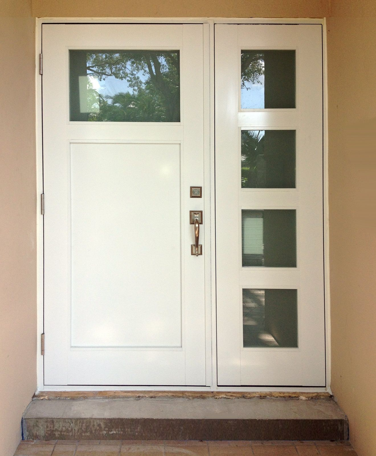 Impact Resistant Entrance Door With Sidelite Installed In Miami