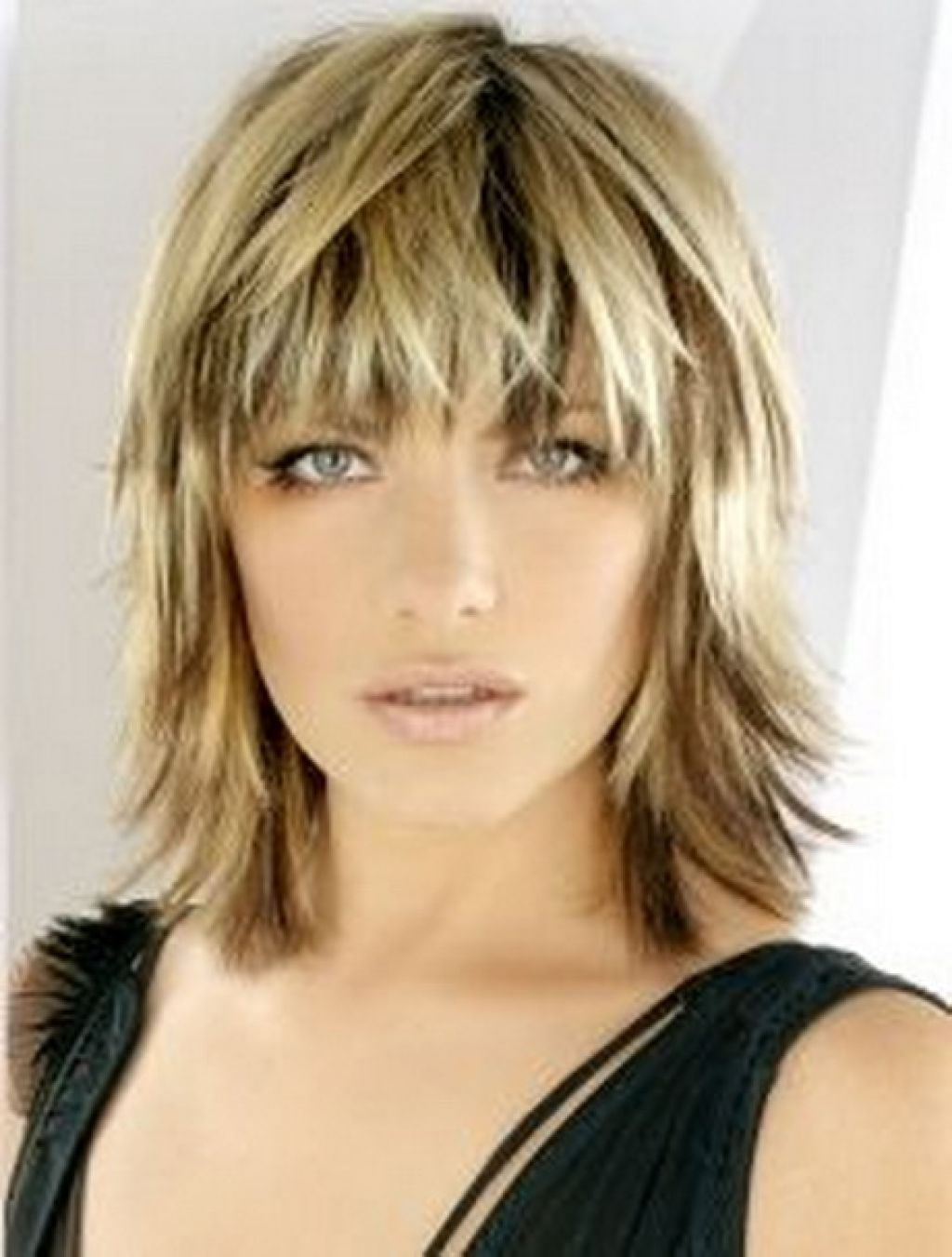 Shag Hairstyles Blonde Medium Length Choppy Shag Haircut With Wispy Bangs And Dark