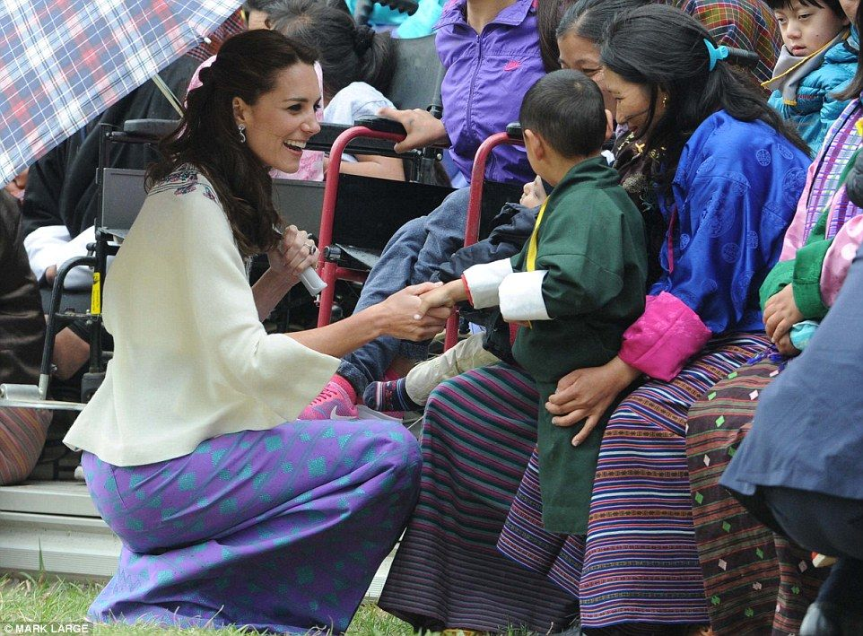 Royal greeting: The Duchess of Cambridge meet local children before  trying their hand at ...
