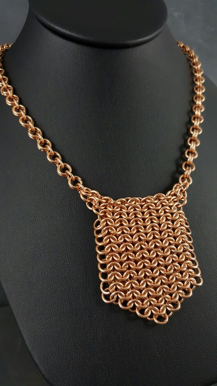 Heat colored bronze shield on handmade bronze chainmaille