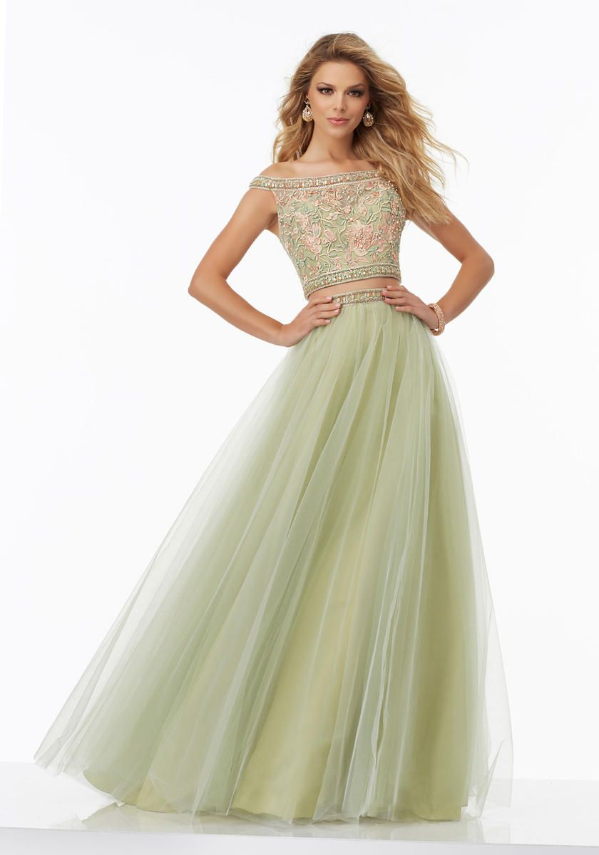 7c2c205866f8 Morilee Prom 99023 is a Two-Piece Prom Dress with Floral Embroidered Off -the-Shoulder Bodice and Flowy Net Skirt. Skirt Accented with Beaded  Waistline ...