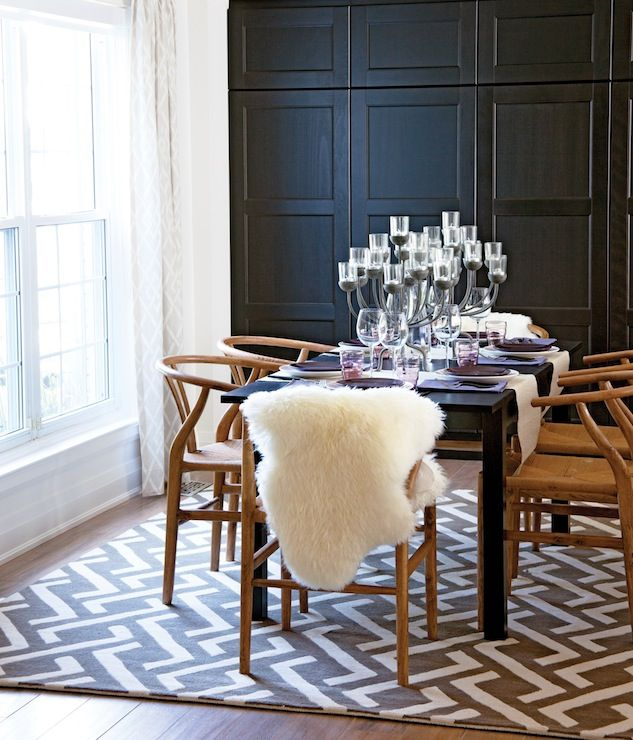 Black Wall Cabinetry, Candelabra, Geometric Rug, Parsons Table, Wishbone  Chairs In Dining Room Via Chatelaine