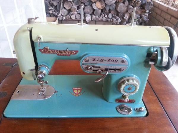 Vintage Aqua/Teal Colored DRESSMAKER Sewing Machine With Table And Hideaway  Cabinet. In Fantastic