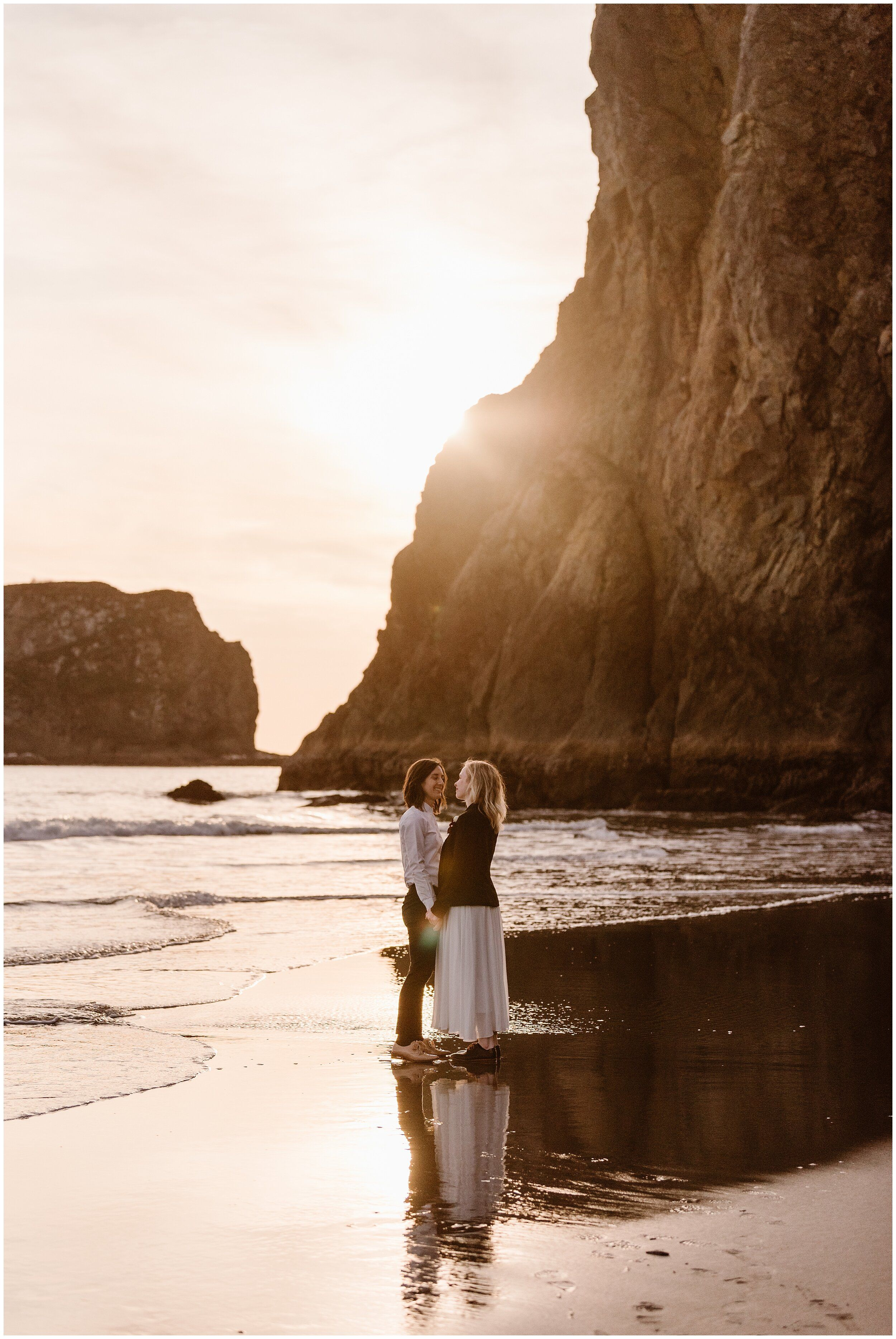 Two Brides Hold Hands On The Oregon Coast As They Explore After Their Elopement Ceremony In 2020 Oregon Coast Wedding Free Wedding Venues Beach Elopement