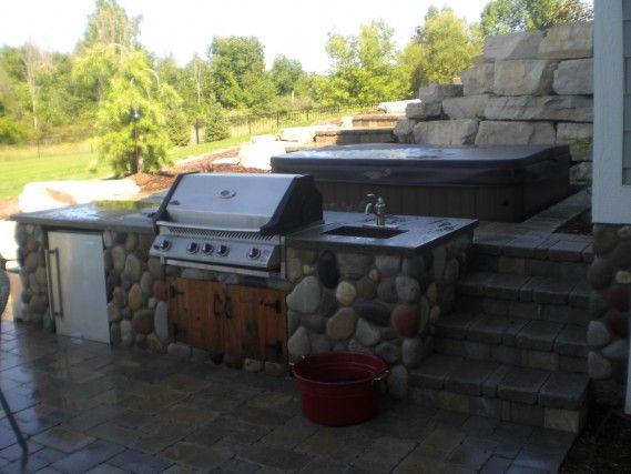 Outdoor Kitchen With Napoleon Grill Custom Cedar Doors Fridge Sink And Natural Stone Veneer By Signature Natural Stone Veneer Outdoor Kitchen Stone Veneer