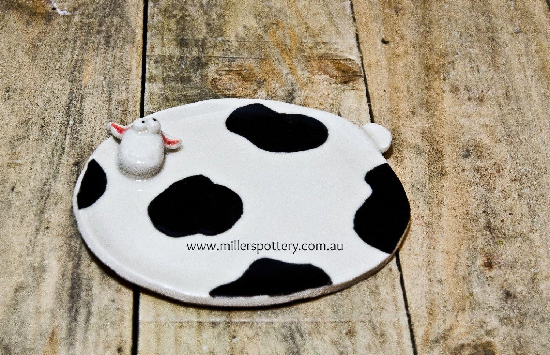 Australian handmade ceramic cow spoon rest by www.millerspottery.com