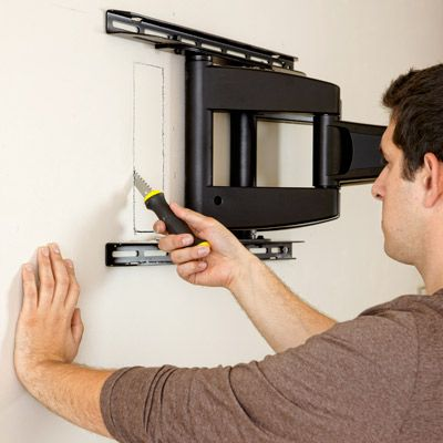 How To Hang A Flat Screen Tv Hanging Tv On Wall Diy Tv Mounting
