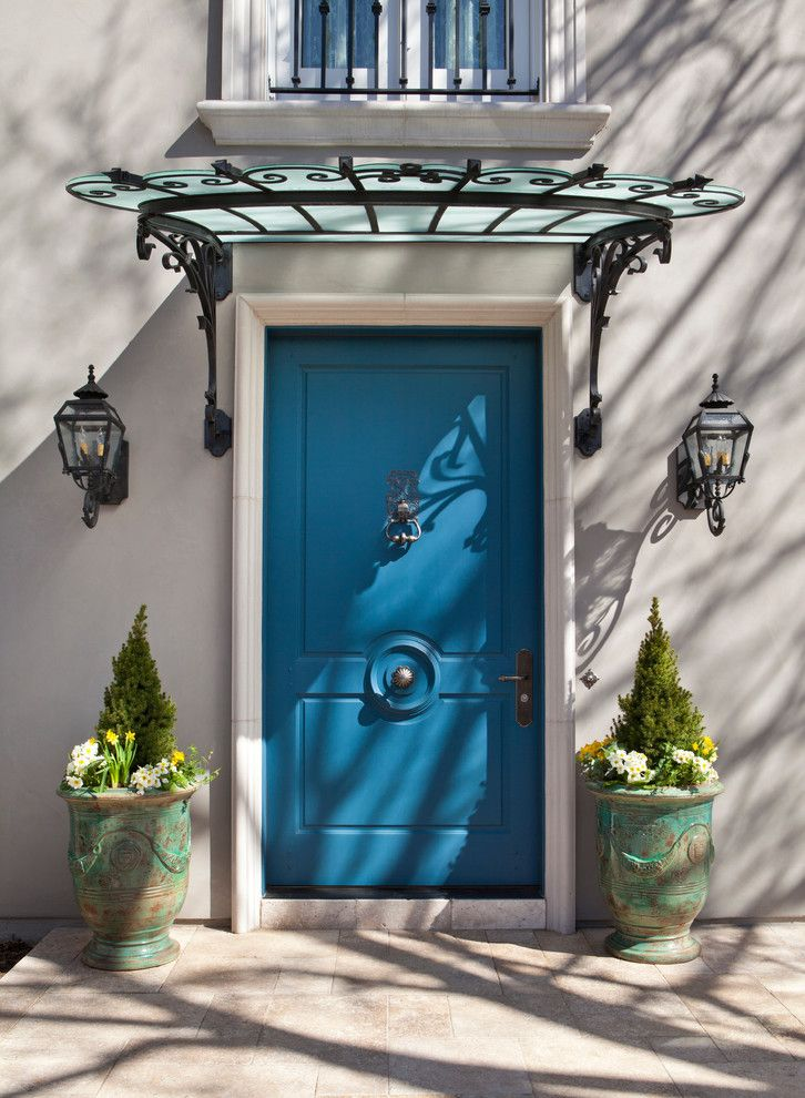 blue door with glass awning and black lanterns linda l floyd