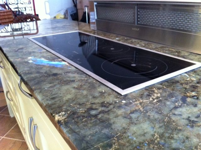 A Rare Ancient Spectrolite Laden That S The Shimmering Gemstone Granite From Madagascar One We Sourced And Installed Granite Worktops Kitchen White Granite