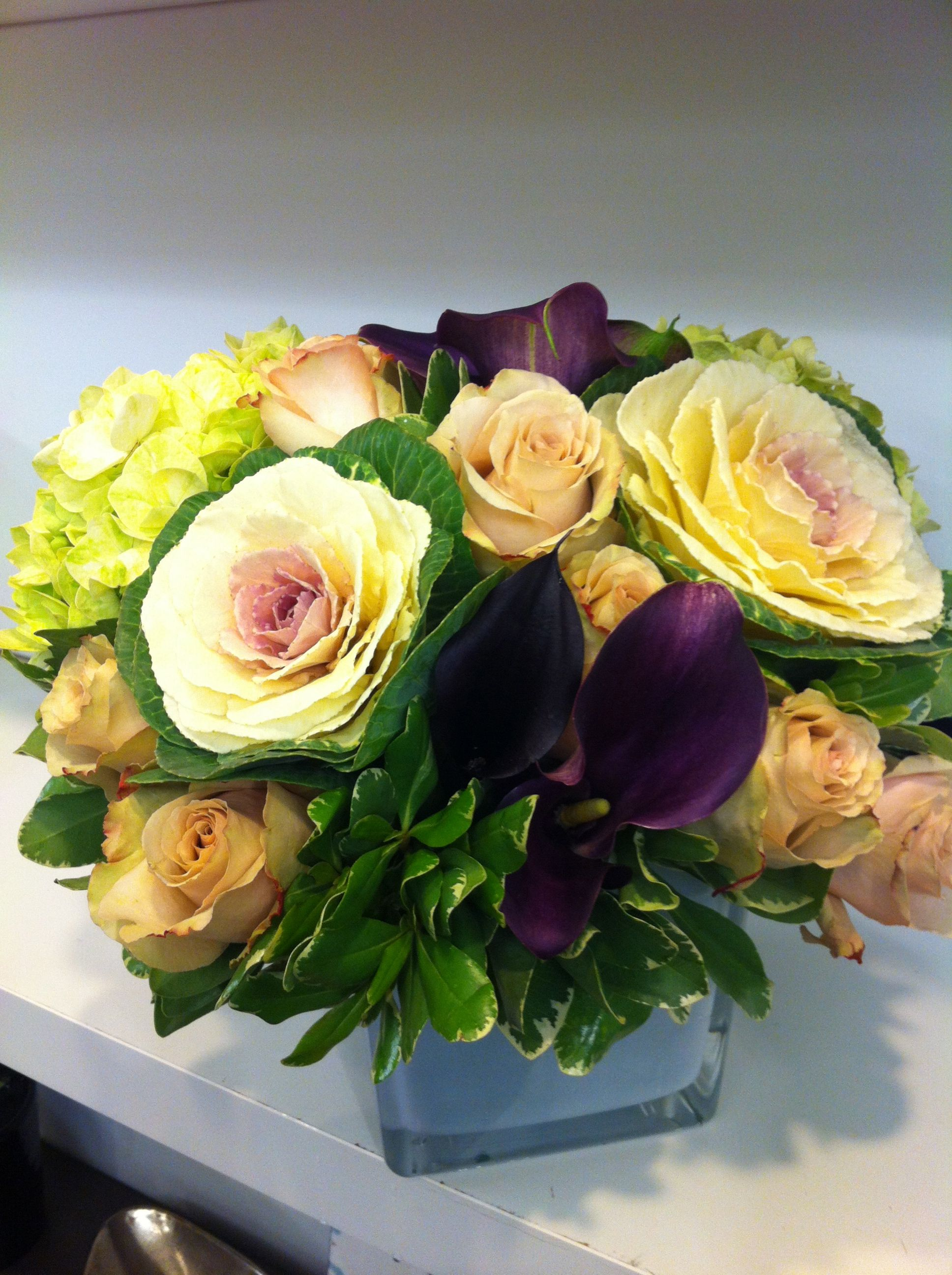 Modern floral arrangement with ornamental cabbage, roses and calla ...
