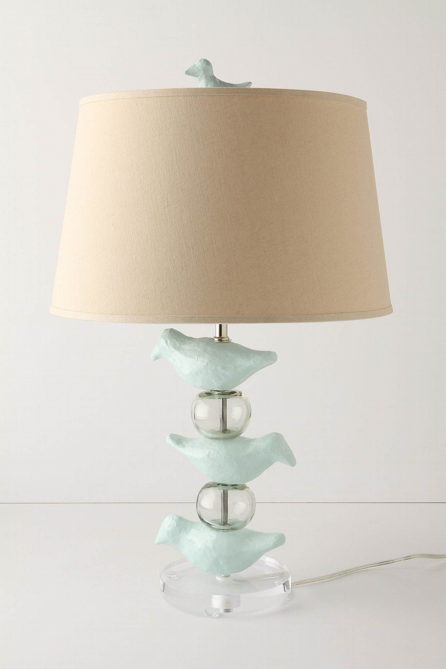 I heart this birdie lamp!  Too spendy for me, but I'm thinking about recreating it from a lamp kit.