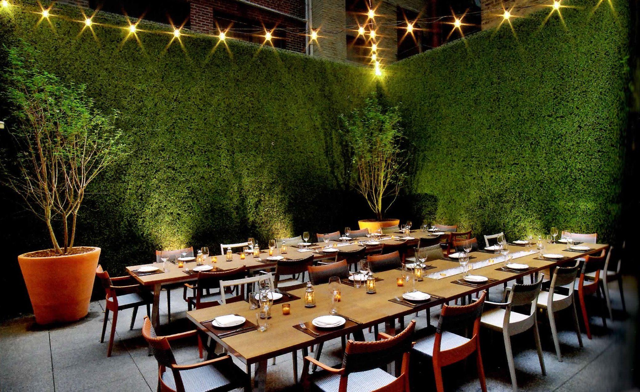 greenery wall behind outdoor bar greenery