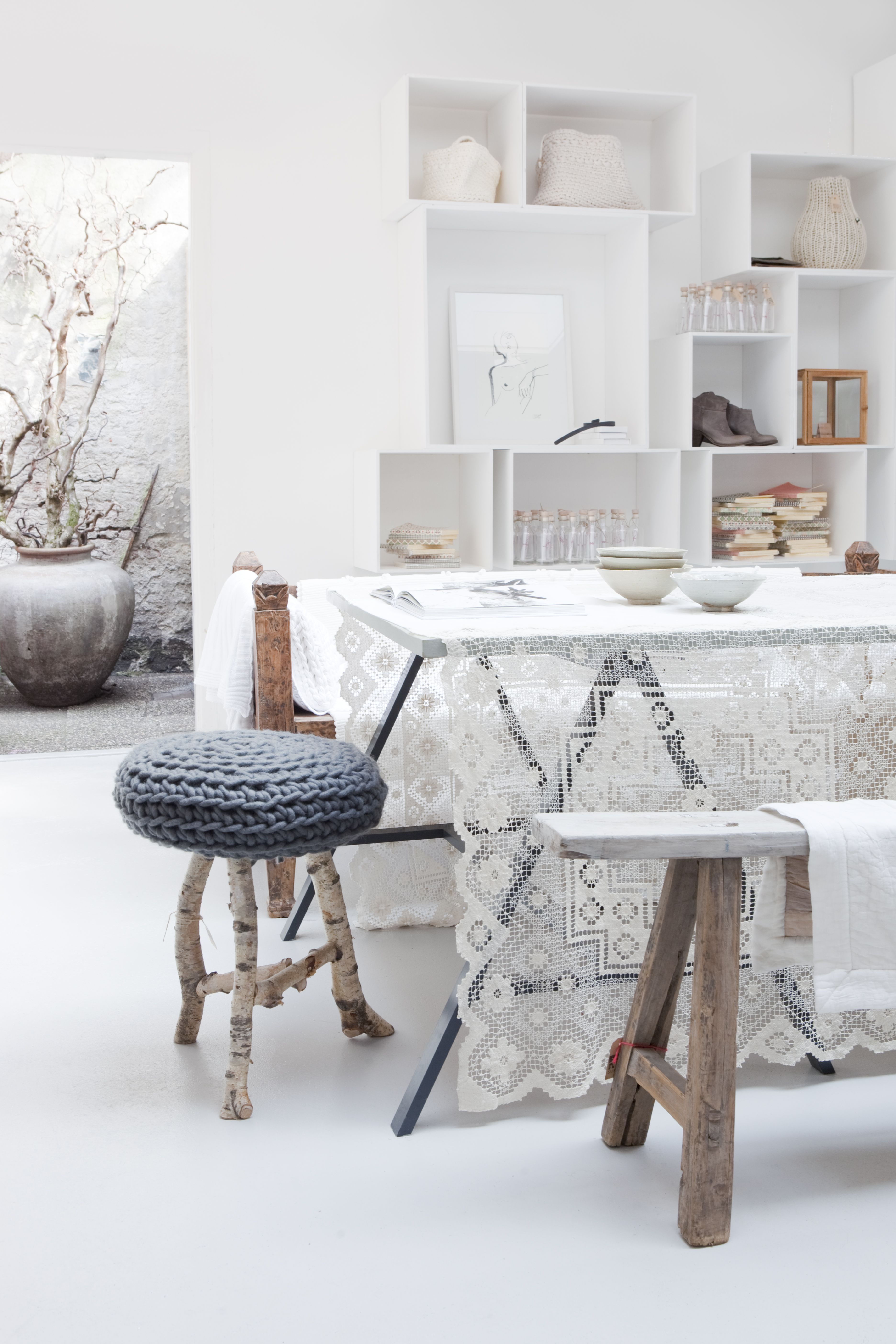 Sukha Amsterdam, over our modern black table, could look awesome, OR like someone was in the process of packing old textiles away?