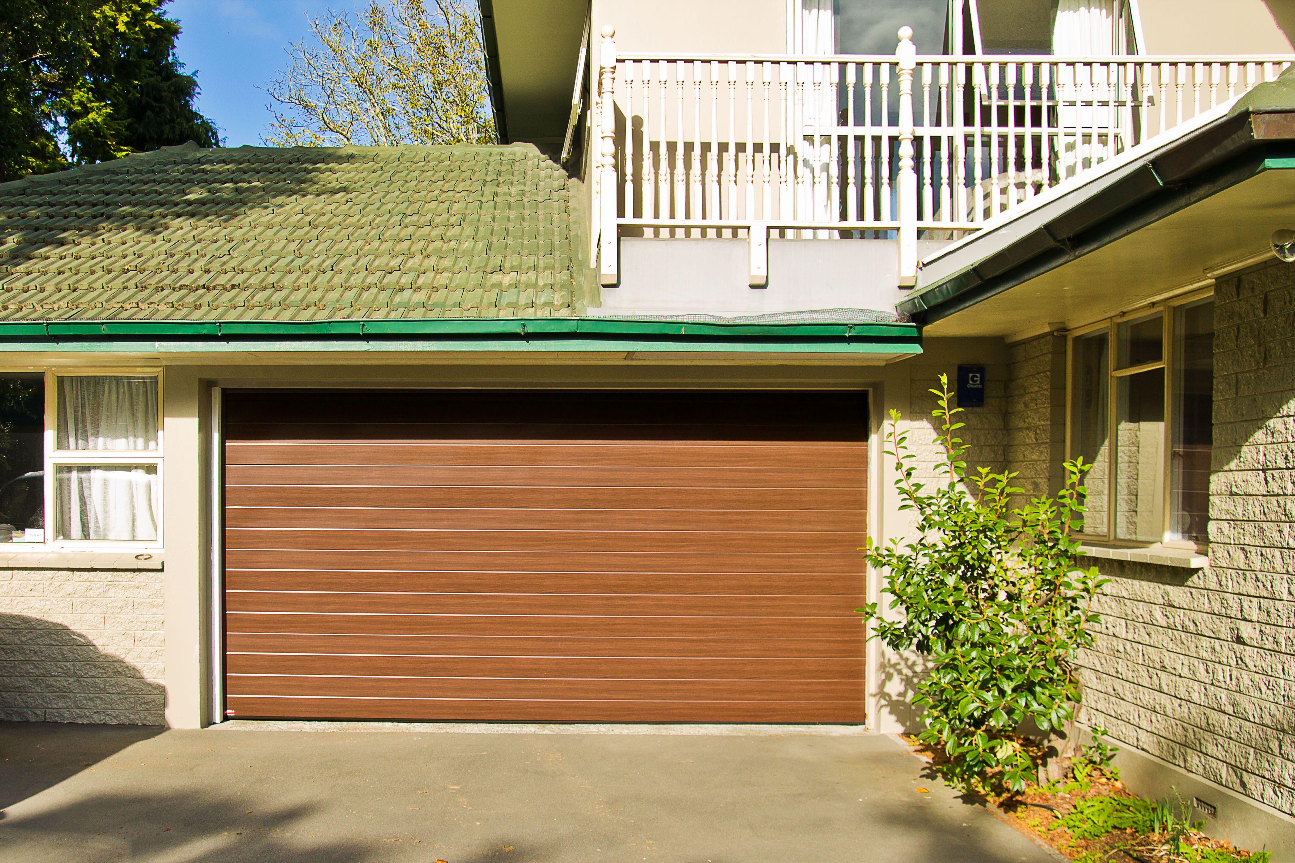 Dominator Naturesteel Sectional Door In Oak Garage Doors