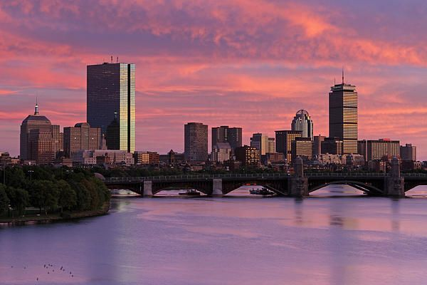 Boston skyline photography at sunset showing famous landmarks such as John Hancock building, Prudential Center and Longfellow Bridge while the sky is on fire displaying orange, pink, purple and red sunset colors.  Good light and happy photo making!  My best,  Juergen www.RothGalleries.com www.ExploringTheLight.com http://whereintheworldisjuergen.blogspot.com https://www.facebook.com/naturefineart @NatureFineArt