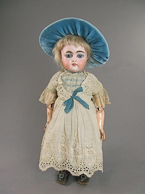 Marked: 192 on socket head, blue sleep eyes, closed mouth, pierced ear with one small ear chip, fully jointed composition body, straight wrists and worn original finish, Nice original pate, wig and outfit including shoes. Very good doll.