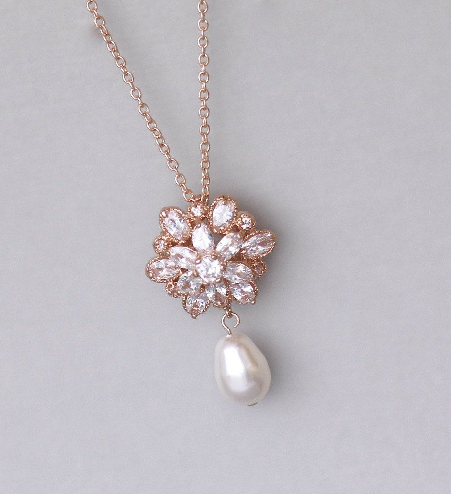 Weve designed this delicate pendant with cz crystals set in gold for