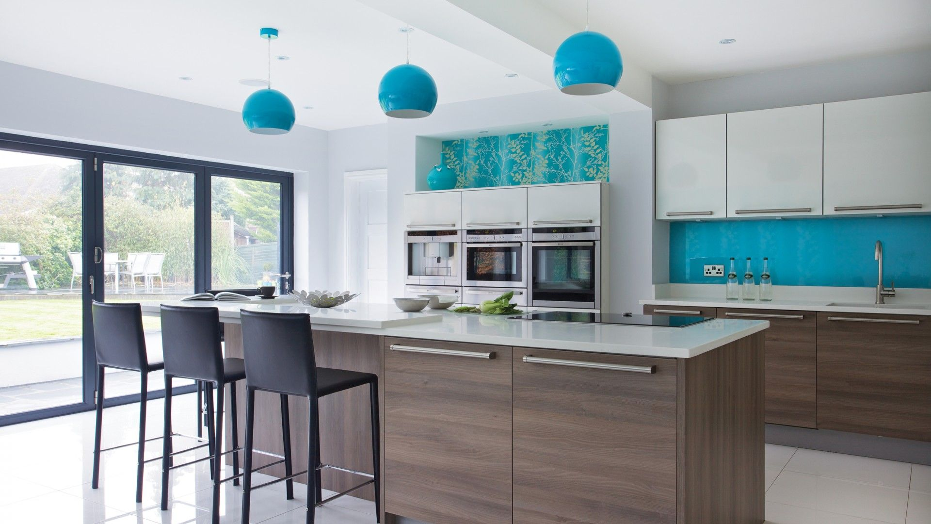 Glossy modern kitchen with bright blue splashback | Kitchen ...
