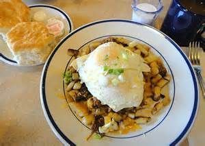 Bob Evans Pot Roast Hash - Delicious hash browns on the bottom, covered with Bob Evans Pot Roast, top that with cheddar cheese and scallions. Finish off the dish with two eggs placed on the top. Delicious.