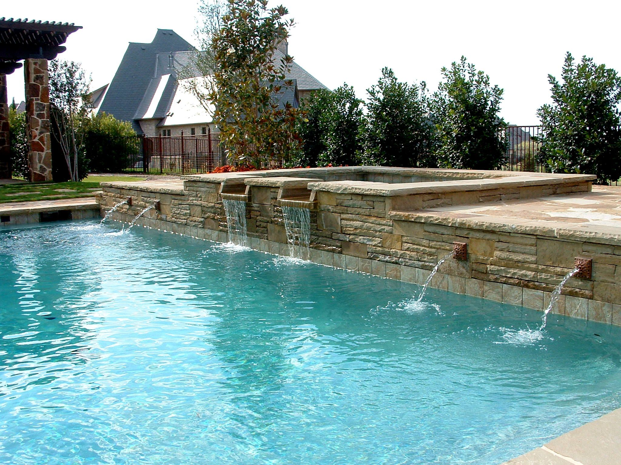 Formal swimming pool with raised spa rosetta fountains for Water pool design