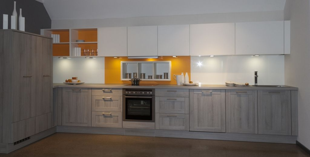 Superbe Grey Wood German Kitchen With White Wall Units And Orange Glass Splashback