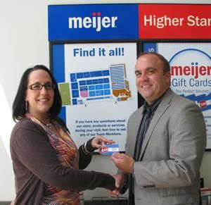 Mary Johanson, Belleville Meijer Store manager, presents Brent ...